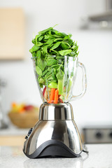 Green vegetable smoothie in blender