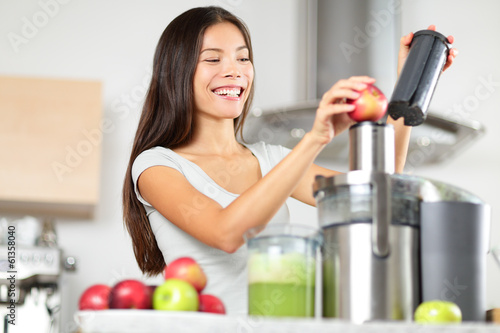 Juicing - woman making apple and vegetable juice