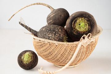 Basket with four black radishes