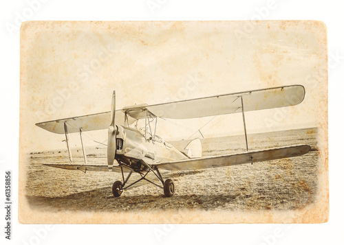 Retro image of the old aircraft on vintage paper.