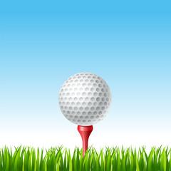 Golf ball on a tee on a grass