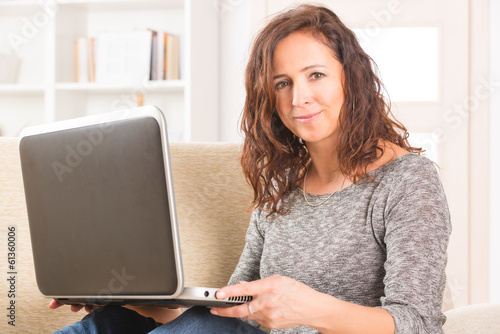 Happy woman with computer