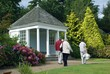 visitors walking in front of summerhouse