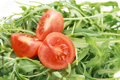 Fresh arugula with tomatoes salad.