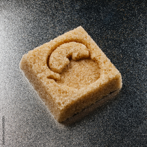 Sugar cube made of brown sugar with the shape of a large kettle