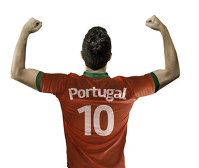 Portuguese soccer player celebrates on white background