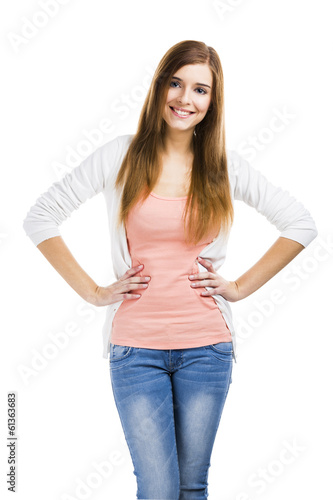 Beautiful blonde woman standing over a white background