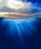 sea or ocean underwater with sunset sky
