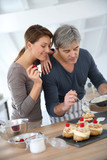 Couple preparing pastry together at home