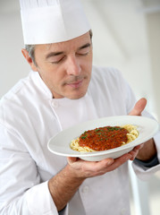 Chef in kitchen preparing italian dish