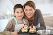 Mother and daughter preparing cream puffs