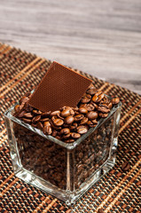 Delicious chocolate in a jar of coffee beans