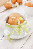 Eggs easter with a ribbon on a wooden background