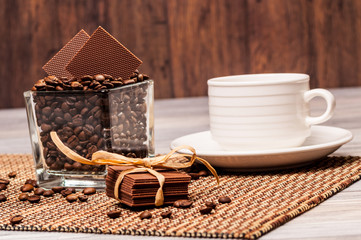Decorated chocolate and coffee on the table