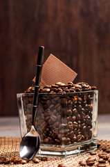 Glass pot with coffee beans and chocolate