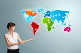 Young woman presenting colorful world map