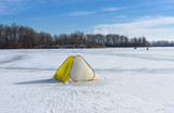 Tent of winter fisherman on a frozen river