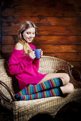 Beautiful young woman holding a coffee cup