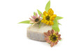 bar of natural soap and flowers