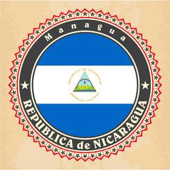 Vintage label cards of Nicaragua flag. Vector