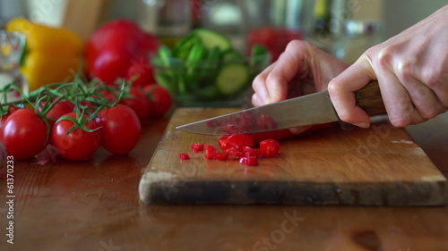 Slicing hot pepper on chopping board, super slow motion,