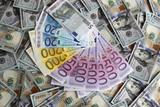 Euro banknotes on a background of one hundred dollar banknotes