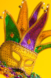 Colorful Mardi Gras or venetian mask or costume on yellow