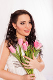 Romantic girl with pink tulips