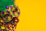 Fototapety Colorful Mardi Gras or venetian mask on yellow