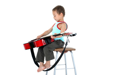 young guitar player 4 year old on a white background