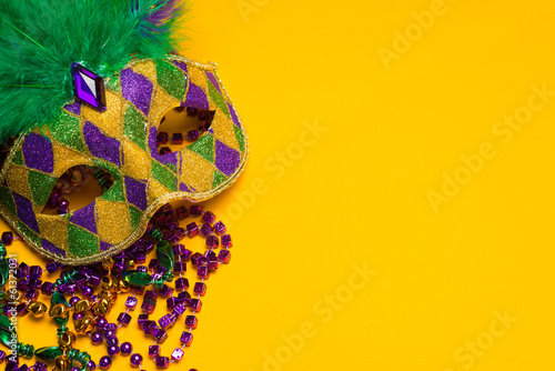 Fotobehang Carnaval Colorful Mardi Gras or venetian mask on yellow