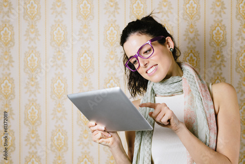 Vintage fashion woman with digital tablet