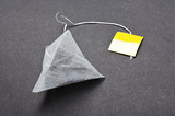 Pyramid shape teabag on the dark background