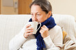 woman in warm scarf with hot cup