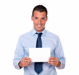 Cute hispanic guy holding a blank card