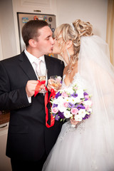 Vertical portrait of kissing newly married couple