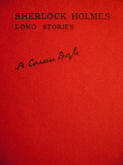 red front cover of conan doyles sherlock holmes long stories
