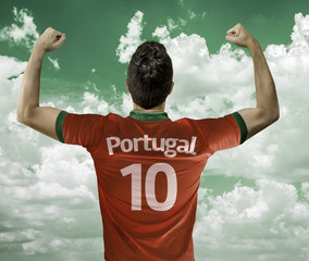 Portuguese soccer player celebrates on green clouds