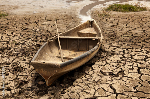 old boat on dry lake - 61377270