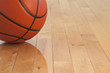 Low angle view of basketball on wooden gym floor