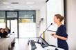 Leinwanddruck Bild - Pretty, young business woman giving a presentation