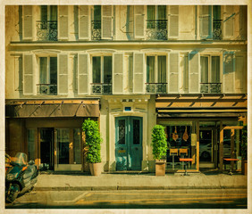 Parisian facade of house with the old cafe. Vintage photo