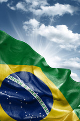 Flag of Brazil with a beautiful blue sky as the background