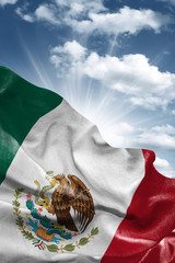 Flag of Mexico with a beautiful blue sky as the background
