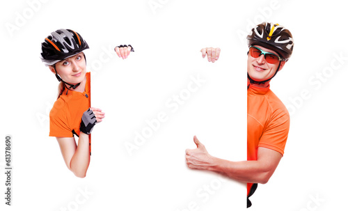 cyclist girl holding the vertical blank board on white backgroun - 61378690