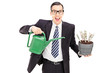 Businessman holding watering can and flowerpot with US dollars