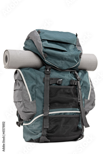 Studio shot of a backpack with exercising mat in it