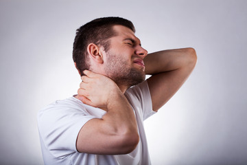 Young man with neck ache