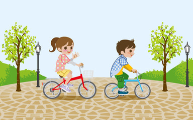 Two kids riding Bicycle, in the park