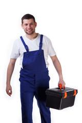 Handyman walking with toolbox